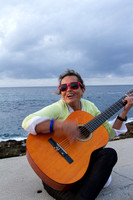 Irina singing on the Malecon wall